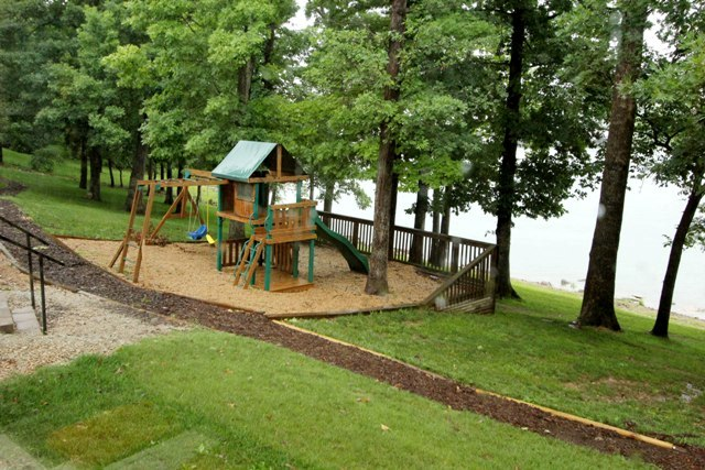 Playground with lake in background