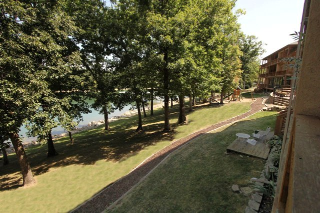 View of grass, trees, and shore from Vickery Resort