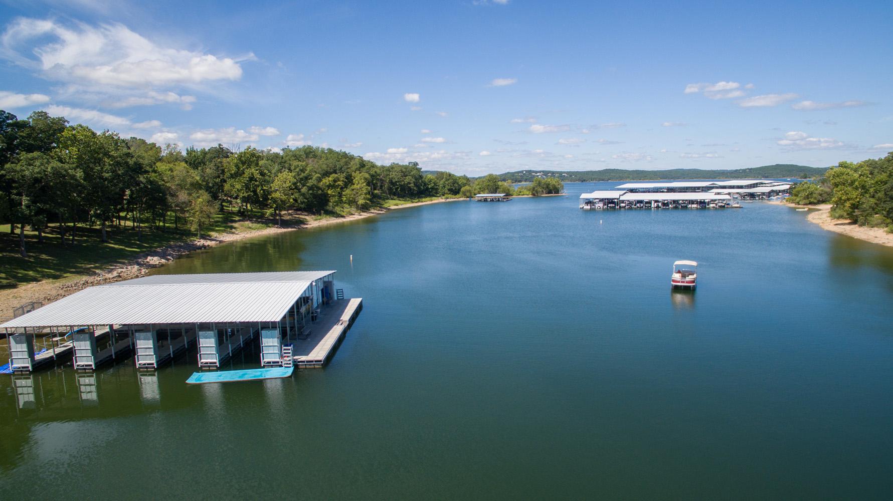 Aerial shot of lake, boat, and docks