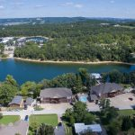 Aerial shot of resort, lake, and docks